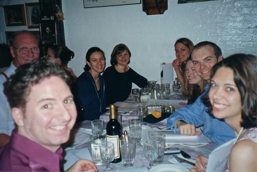 Chris and Kim and guests at dinner